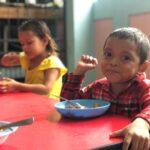 ONETrack International - Honduras children eating